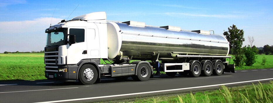 Tanker truck driving on road