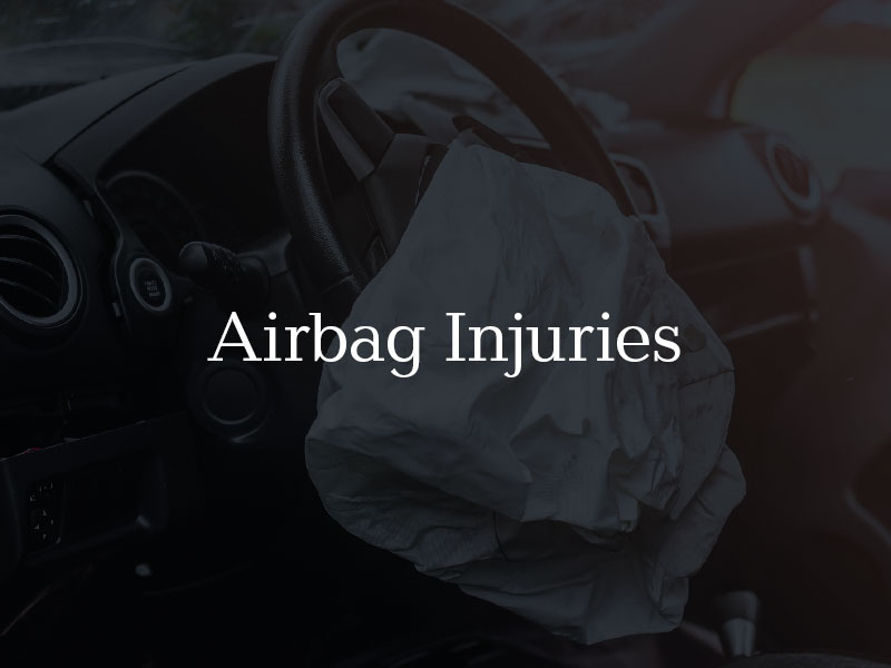Deployed airbag in car